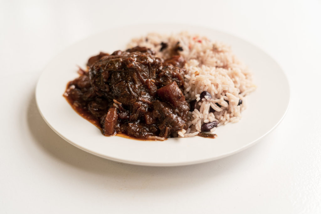 oxtail stew with rice  peas  chef tolu